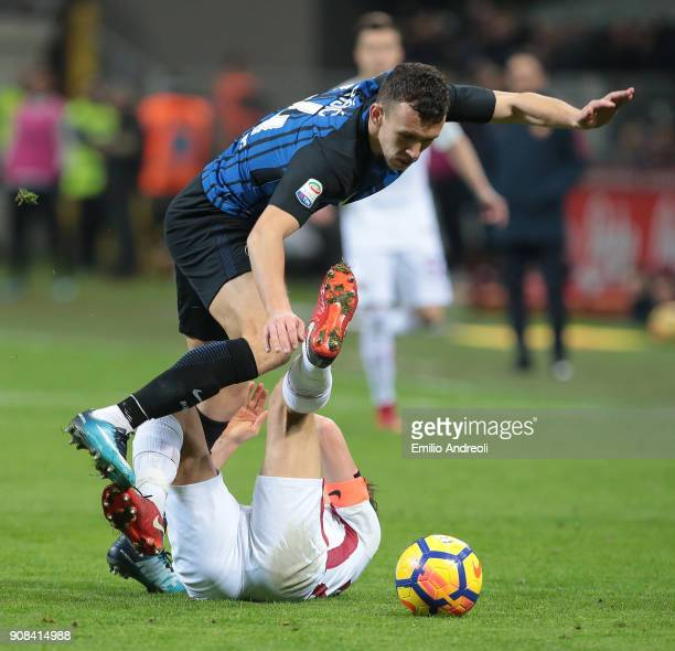 Ivan Perisic of FC Internazionale Milano competes for the ball with Alessandro Florenzi of AS Roma during the Serie A match between FC Internazionale...