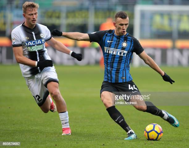 Ivan Perisic of FC Internazionale Milano is challenged by Antonin Barak of Udinese Calcio during the Serie A match between FC Internazionale and...