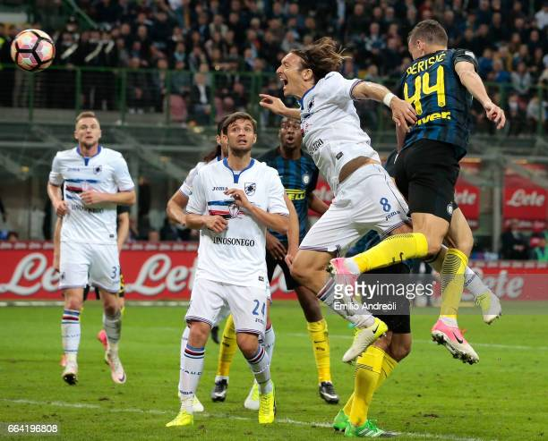Ivan Perisic of FC Internazionale Milano jumps for the ball against Edgar Osvaldo Barreto of UC Sampdoria and misses a chance on goal during the...