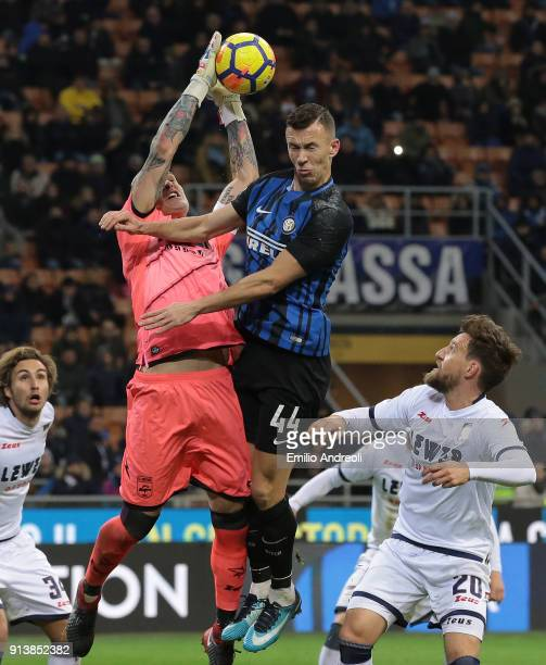 Ivan Perisic of FC Internazionale Milano jumps for the ball against Alex Cordaz of FC Crotone during the serie A match between FC Internazionale and...