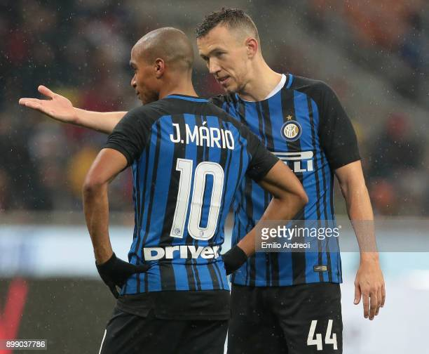 Ivan Perisic of FC Internazionale Milano speaks with his teammate Joao Mario during the TIM Cup match between AC Milan and FC Internazionale at...