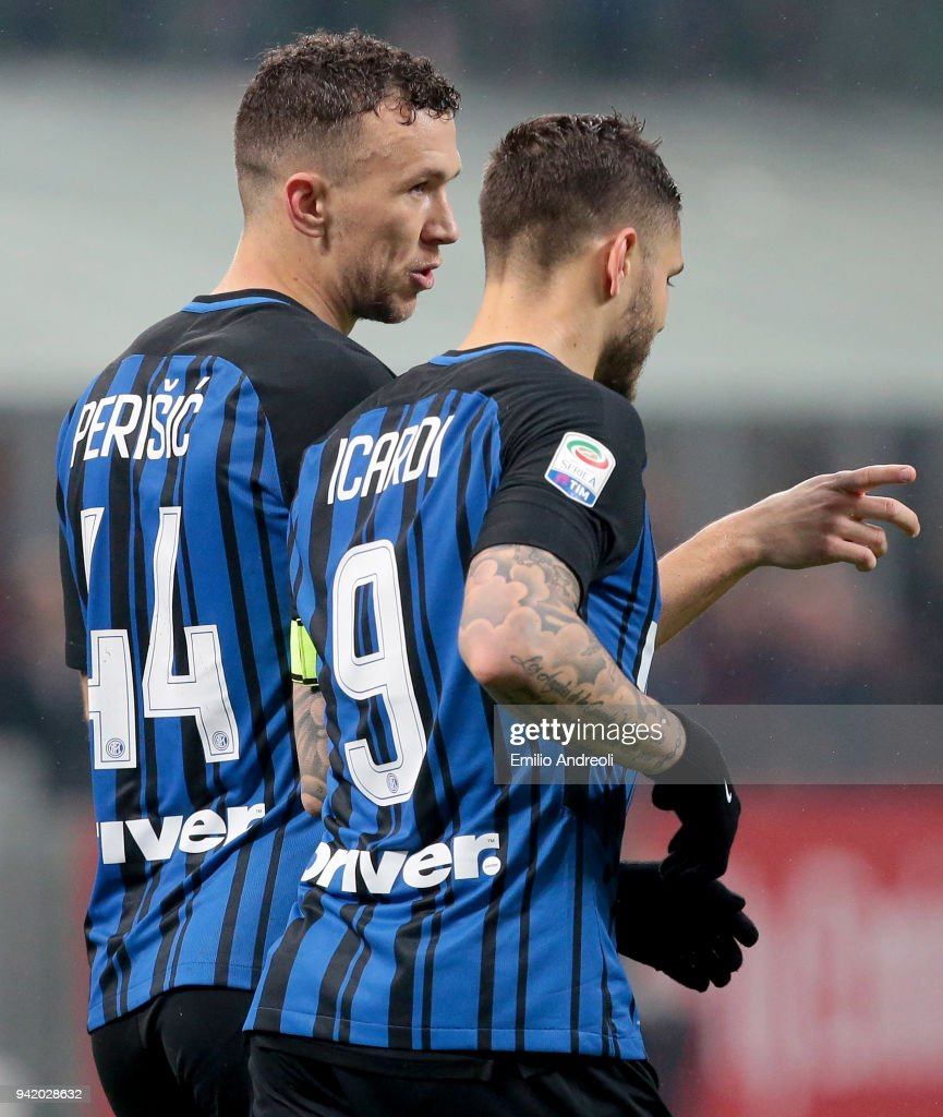 Ivan Perisic (L) of FC Internazionale Milano speaks with his teammate Mauro Emanuel Icardi during the serie A match between AC Milan and FC Internazionale at Stadio Giuseppe Meazza on April 4, 2018 in Milan, Italy.