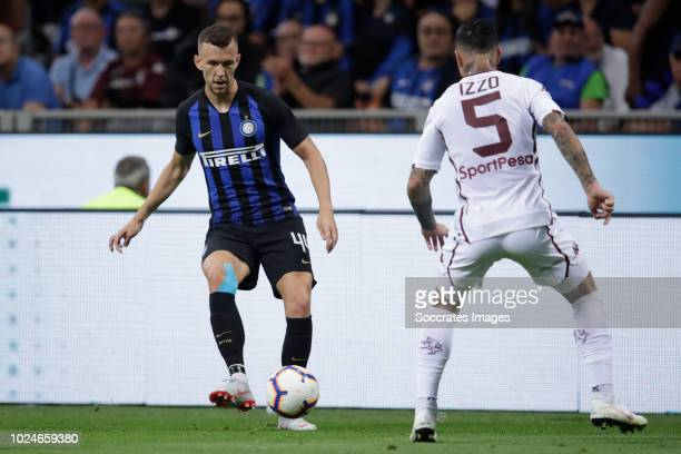 Ivan Perisic of Internazionale Armando Izzo of Torino during the Italian Serie A match between Internazionale v Torino at the San Siro on August 26...