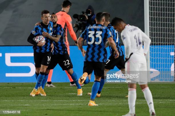 Ivan Perisic of Internazionale Celebrates 2-2 with Arturo Vidal of Internazionale during the UEFA Champions League match between Real Madrid v...