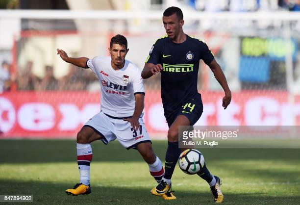 Ivan Perisic of Internazionale holds off the challenge from Davide Faraoni of Crotone during the Serie A match between FC Crotone and FC...