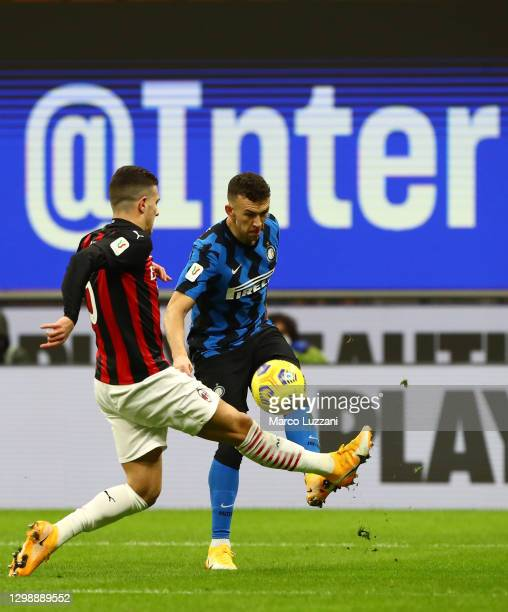 Ivan Perisic of Internazionale is challenged by Diogo Dalot of AC Milan during the Coppa Italia match between FC Internazionale and AC Milan at...