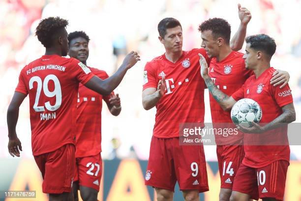 Ivan Perisic of Muenchen celebrates his team's third goal with team mates during the Bundesliga match between FC Bayern Muenchen and 1 FSV Mainz 05...