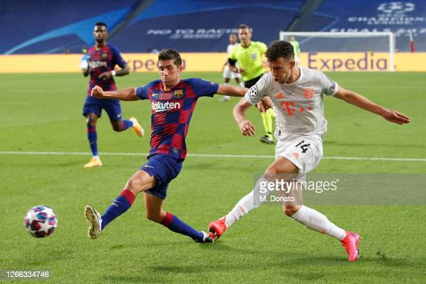 Ivan Perisic of Muenchen is challenged by Sergi Roberto of FC Barcelona during the UEFA Champions League Quarter Final match between Barcelona and...