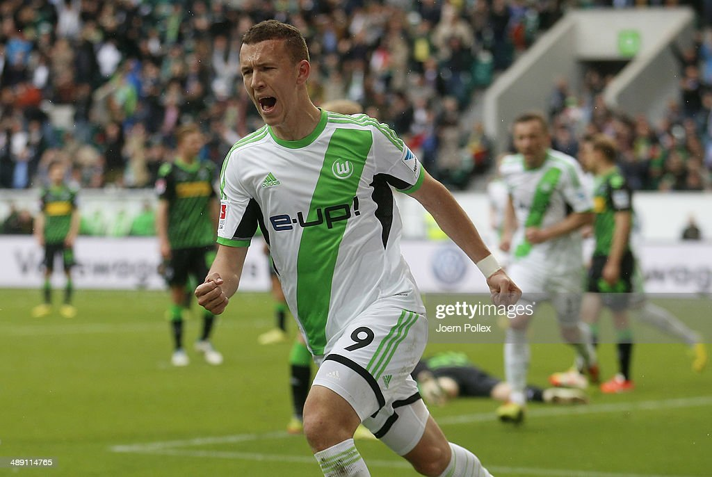 Ivan Perisic of Wolfsburg celebrates after scoring his team's second goal during the Bundesliga match between at Volkswagen Arena on May 10, 2014 in Wolfsburg, Germany.