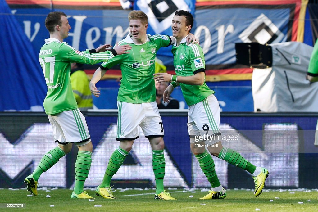 Ivan Perisic (R) of Wolfsburg celebrates after scoring their first goal during the Bundesliga match between Hamburger SV and VfL Wolfsburg at Imtech Arena on April 19, 2014 in Hamburg, Germany.
