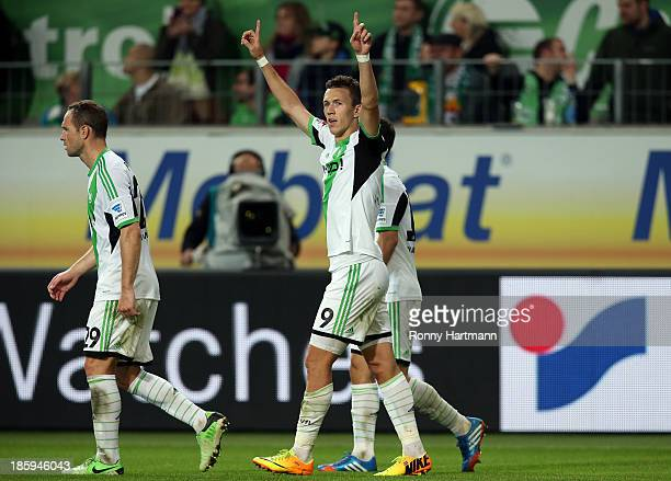 Ivan Perisic of Wolfsburg celebrates scoring his teams third goal with Jan Polak and Diego during the Bundesliga match between VfL Wolfsburg and...