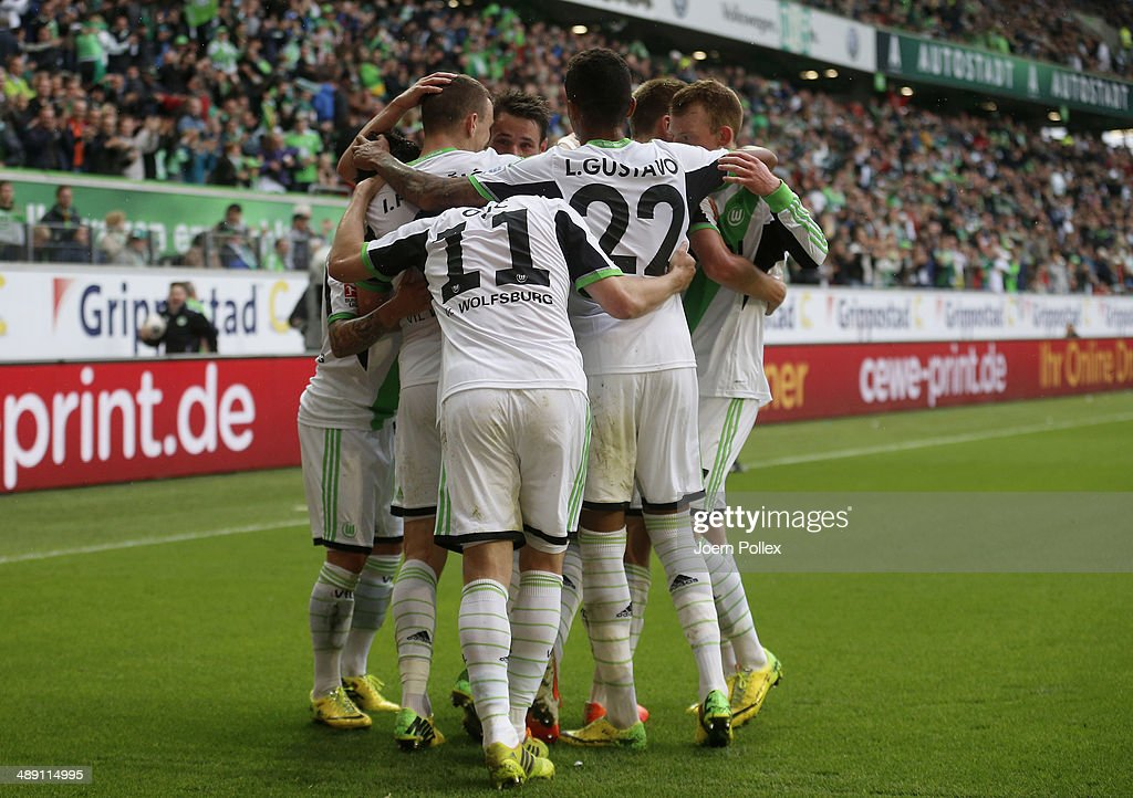Ivan Perisic (2nd R) of Wolfsburg celebrates with his team mates after scoring his team's second goal during the Bundesliga match between at Volkswagen Arena on May 10, 2014 in Wolfsburg, Germany.