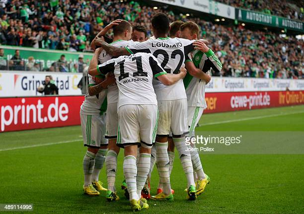 Ivan Perisic of Wolfsburg celebrates with his team mates after scoring his team's second goal during the Bundesliga match between at Volkswagen Arena...