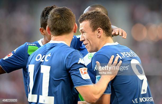 Ivan Perisic of Wolfsburg celebrates with teammates after scoring the opening/first goal during the Bundesliga match between VfB Stuttgart and VfL...