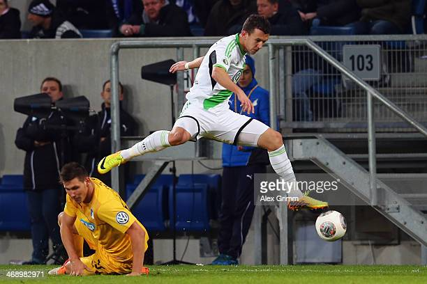 Ivan Perisic of Wolfsburg outjumps Niklas Suele of Hoffenheim during the DFB Cup quarterfinal match between 1899 Hoffenheim and VfL Wolfsburg at...