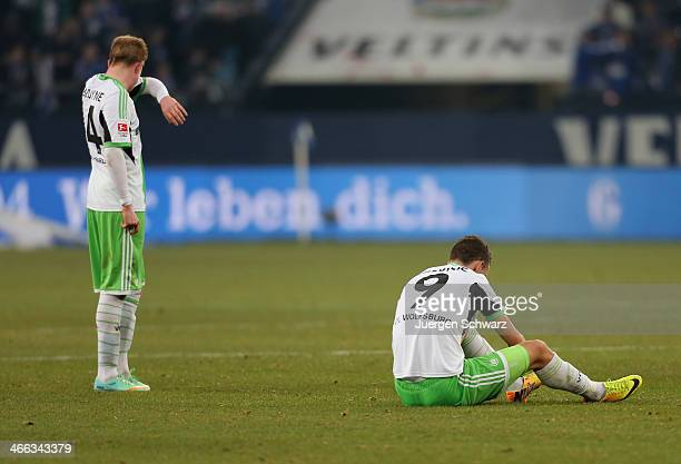 Ivan Perisic of Wolfsburg sits on the pitch near Kevin De Bruyne after the Bundesliga match between FC Schalke 04 and VfL Wolfsburg at VeltinsArena...