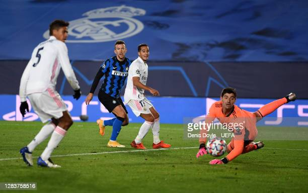 Ivan Perisic scores his sides second goal past Thibaut Courtois of Real Madrid during the UEFA Champions League Group B stage match between Real...