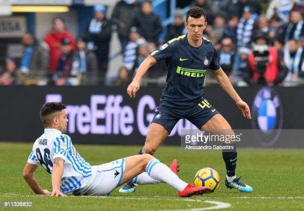 Ivan Persic of FC Internazionale competes for the ball with Alberto Grassi of Spal during the serie A match between Spal and FC Internazionale at...