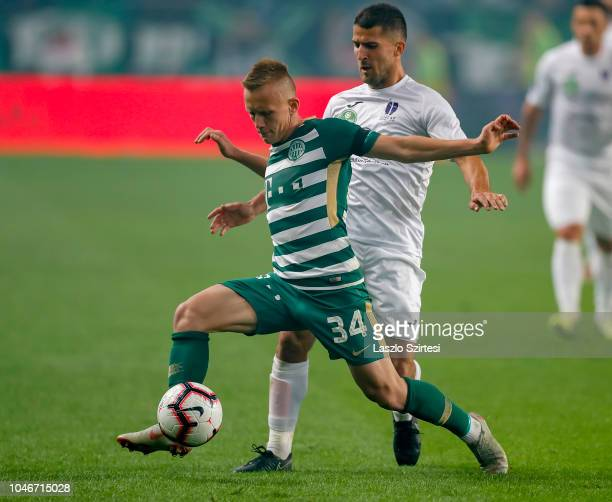 Ivan Petryak of Ferencvarosi TC covers the ball from Bojan Sankovic of Ujpest FC during the Hungarian OTP Bank Liga match between Ferencvarosi TC and...
