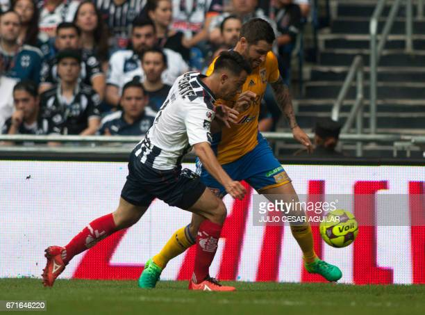 Ivan Piris of Monterrey vies for the ball with Andre Pierre Gignac of Tigres during the Mexican Clausura 2017 tournament football match in Monterrey...