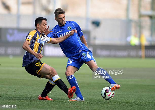 Ivan Piris of Udinese Calcio competes with Domenico Berardi of US Sassuolo during the Serie A match between Udinese Calcio and US Sassuolo Calcio at...