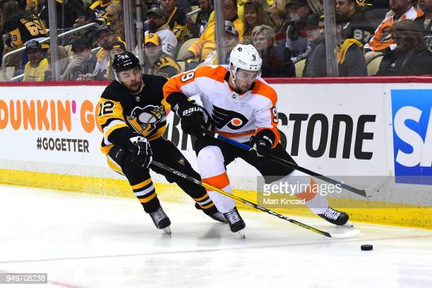 Ivan Promorov of the Philadelphia Flyers skates with the puck against Dominik Simon of the Pittsburgh Penguins in Game Five of the Eastern Conference...