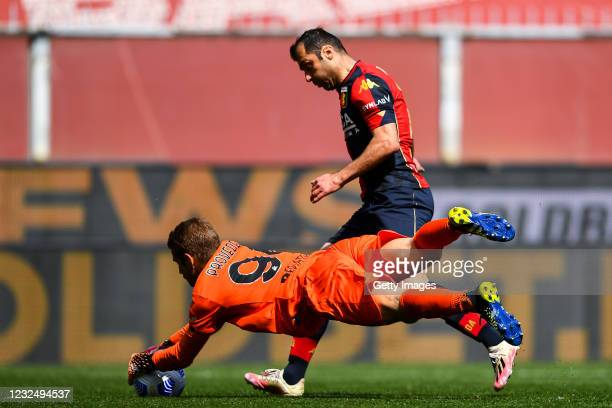 Ivan Provedel of Spezia saves the ball against Goran Pandev of Genoa during the Serie A match between Genoa CFC and Spezia Calcio at Stadio Luigi...