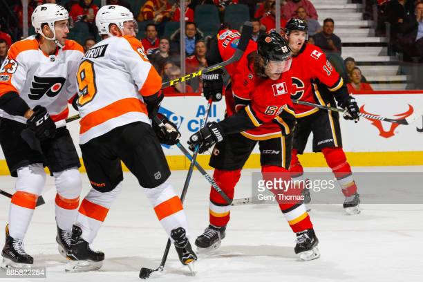 Ivan Provorov and Brandon Manning of the Philadelphia Flyers try to block Jaromir Jagr in a game against the Philadelphia Flyers at the Scotiabank...