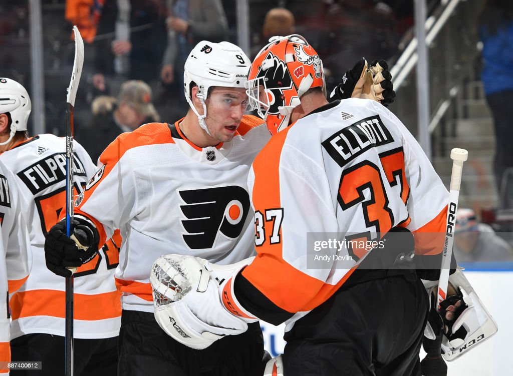 Ivan Provorov #9 and Brian Elliott #37 of the Philadelphia Flyers celebrate after winning the game against the Edmonton Oilers on December 6, 2017 at Rogers Place in Edmonton, Alberta, Canada.