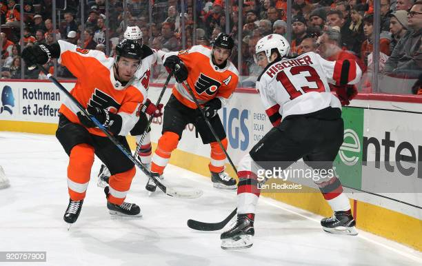 Ivan Provorov and Valtteri Filppula of the Philadelphia Flyers defend Nico Hischier of the New Jersey Devils on February 13 2018 at the Wells Fargo...