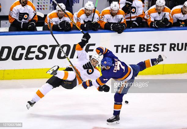 Ivan Provorov of the Philadelphia Flyers and Jordan Eberle of the New York Islanders collide during the first overtime period in Game Six of the...