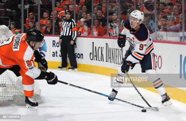 Ivan Provorov of the Philadelphia Flyers attempts to break up a pass by Connor McDavid of the Edmonton Oilers on October 21 2017 at the Wells Fargo...