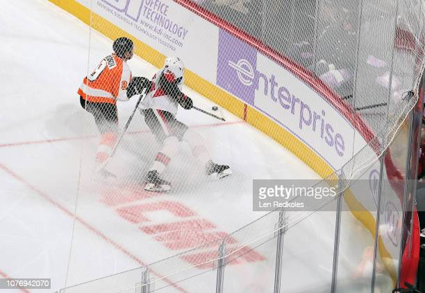 Ivan Provorov of the Philadelphia Flyers battles for the puck in the corner against Magnus Paajarvi of the Ottawa Senators on November 27 2018 at the...