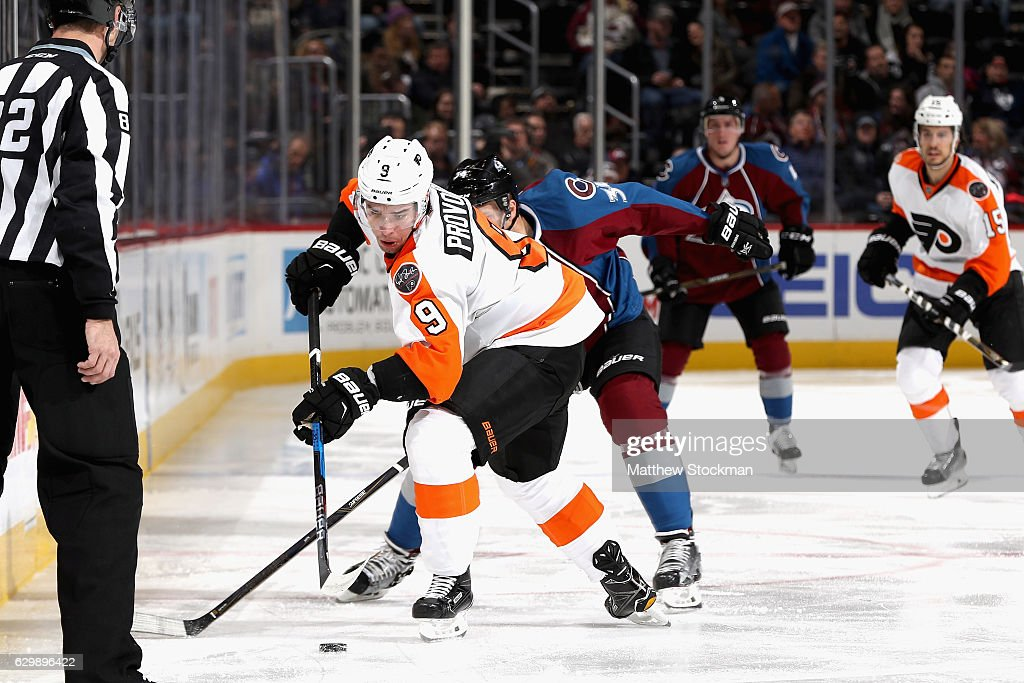 Ivan Provorov #9 of the Philadelphia Flyers brings the puck down ice against Carl Soderberg #34 of the Colorado Avalanche at the Pepsi Center on December 14, 2016 in Denver, Colorado.