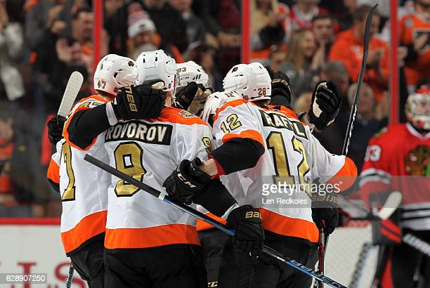 Ivan Provorov of the Philadelphia Flyers celebrates a second period goal with teammates Jakub Voracek Andrew MacDonald Michael Raffl and Claude...