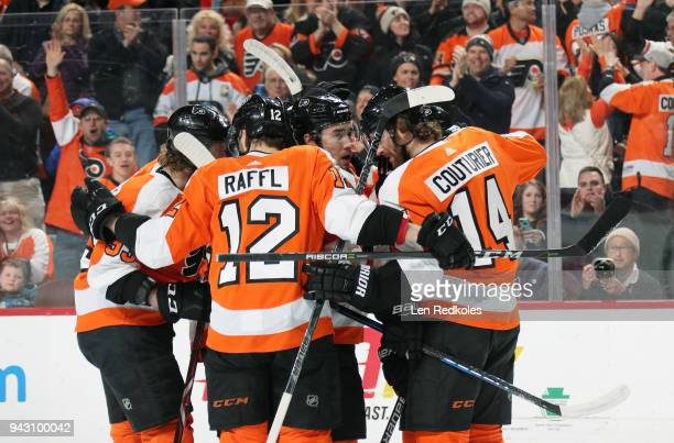 Ivan Provorov of the Philadelphia Flyers celebrates his first period goal against the New York Rangers with Jakub Voracek Michael Raffl and Sean...