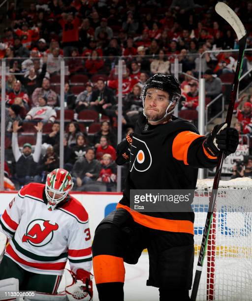 Ivan Provorov of the Philadelphia Flyers celebrates his goal in the third period as Cory Schneider of the New Jersey Devils reacts on March 01 2019...