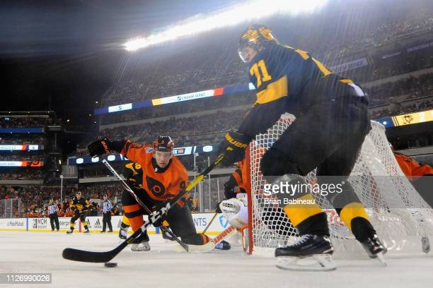 Ivan Provorov of the Philadelphia Flyers defends a play by Evgeni Malkin of the Pittsburgh Penguins from behind the net during the 2019 Coors Light...