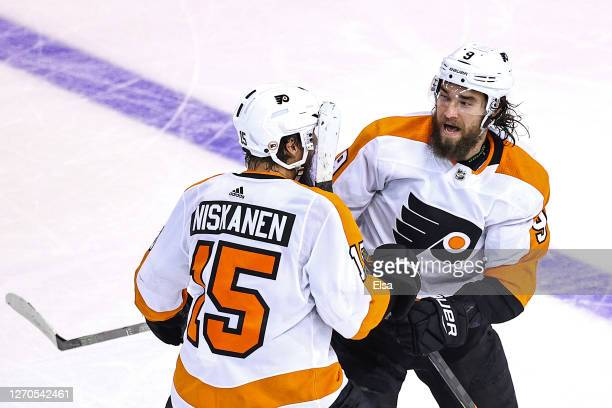 Ivan Provorov of the Philadelphia Flyers is congratulated by his teammate Matt Niskanen after scoring the game-winning goal during the second...