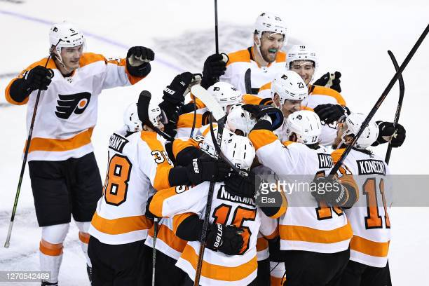 Ivan Provorov of the Philadelphia Flyers is congratulated by his teammates after scoring the gamewinning goal during the second overtime period...