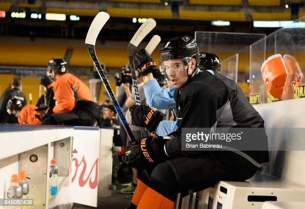 Ivan Provorov of the Philadelphia Flyers looks on from the bench during practice for the 2017 Coors Light NHL Stadium Series game to be played...