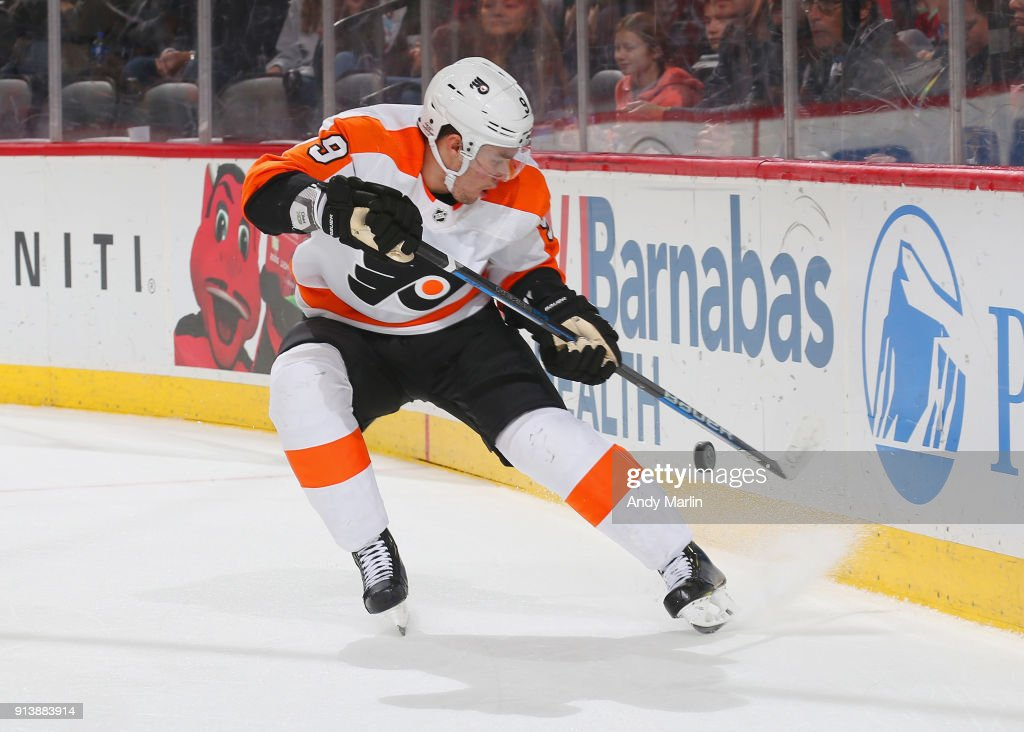 Ivan Provorov #9 of the Philadelphia Flyers plays the puck during the game against the New Jersey Devils at Prudential Center on February 1, 2018 in Newark, New Jersey.