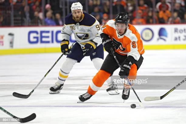 Ivan Provorov of the Philadelphia Flyers skates past Ryan O'Reilly of the Buffalo Sabres during the second period at Wells Fargo Center on December...