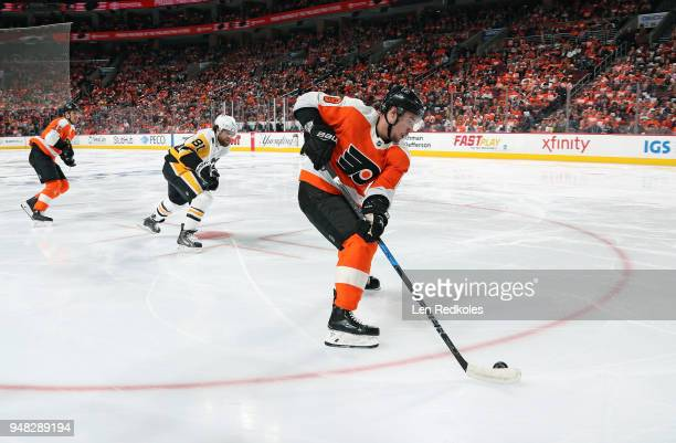 Ivan Provorov of the Philadelphia Flyers skates the puck against Phil Kessel of the Pittsburgh Penguins in Game Three of the Eastern Conference First...