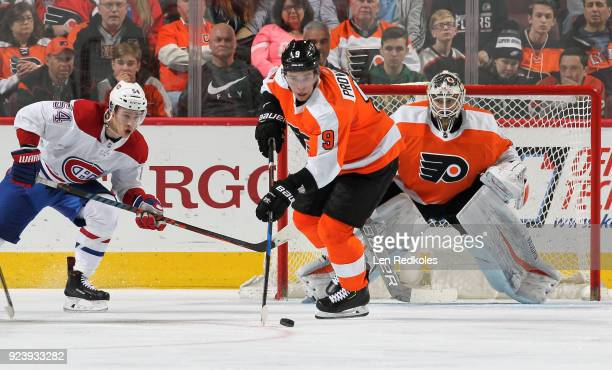 Ivan Provorov of the Philadelphia Flyers skates the puck in front of goaltender Alex Lyon against Charles Hudon of the Montreal Canadiens on February...