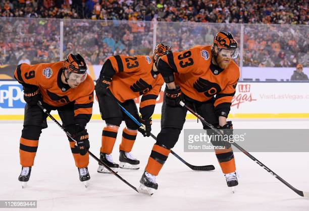 Ivan Provorov Oskar Lindblom and Jakub Voracek of the Philadelphia Flyers line up in position during the 2019 Coors Light NHL Stadium Series game...