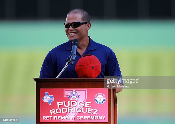 Ivan 'Pudge' Rodriguez of the Texas Rangers speaks during a retirement ceremony before a game against the New York Yankees at Rangers Ballpark in...