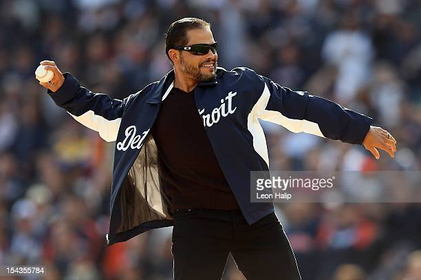 Ivan 'Pudge' Rodriguez throws out the ceremonial first pitch prior to the Detroit Tigers hosting the New York Yankees uring game four of the American...