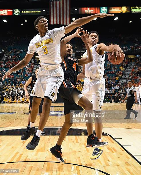 Ivan Rabb of the California Golden Bears knocks the ball away from Derrick Bruce of the Oregon State Beavers as Tyrone Wallace of the Bears defends...
