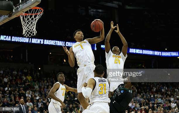 Ivan Rabb and Jordan Mathews of the California Golden Bears go up for a rebound against the Hawaii Warriors in the first half during the first round...